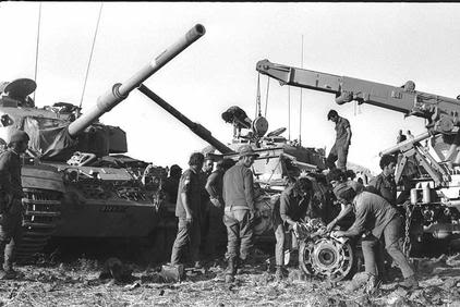 MEMBERS OF THE ENGINEERING CORPS REPAIRING A DAMAGED TANK NEAR THE FRONTLINE ON THE GOLAN HEIGHTS..jpg